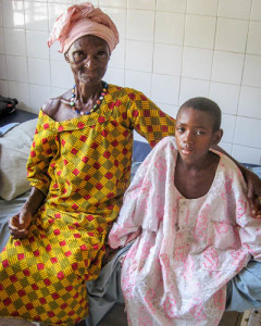 Ali, 9, with his grandmother, recovering from hernia surgery at Holy Spirit Hospital – January 2014.